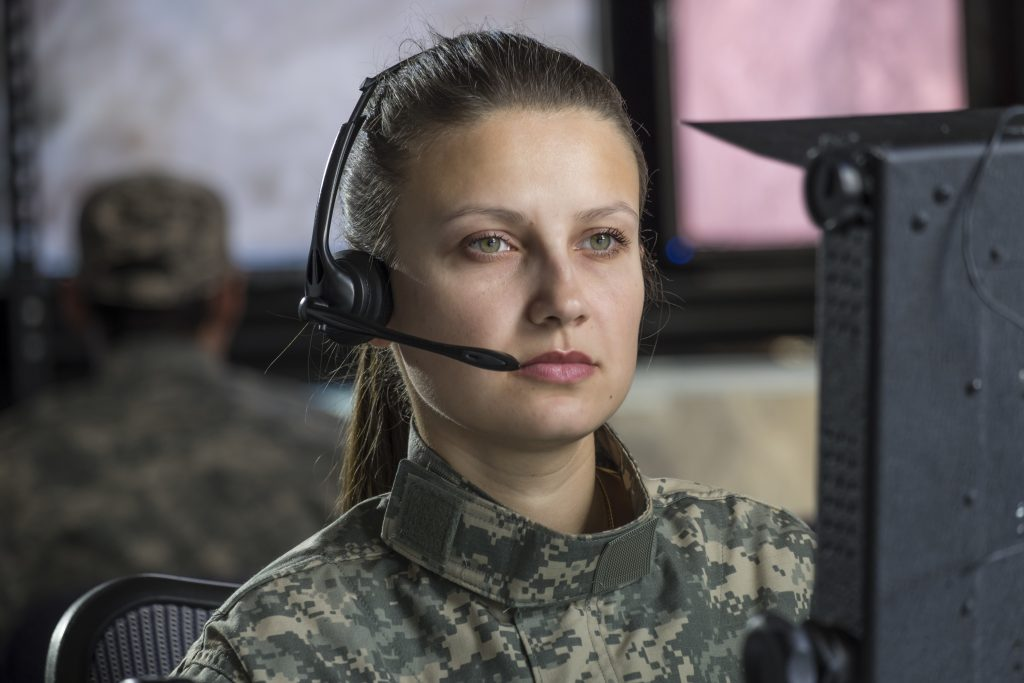 female drone operator on computer
