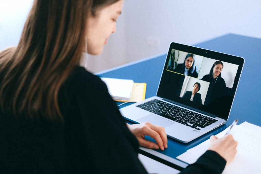Woman working from home on a video conference call on her laptop. WFH