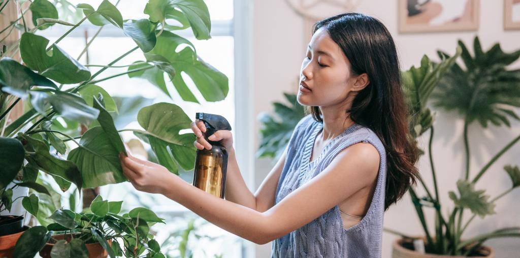 Woman watering her plants on her journey toward self-improvement
